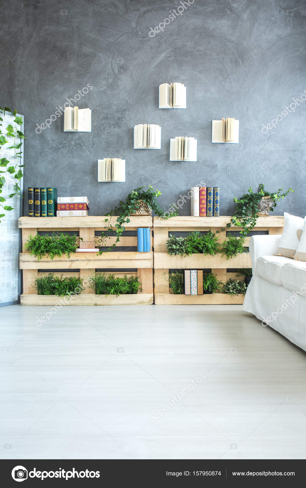 Bookshelf Made Of Pallets In Room Stock Photo