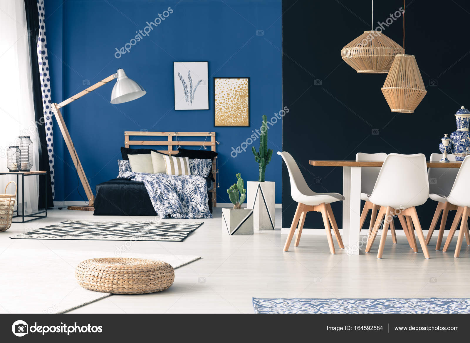 apartment with bedroom communal table wooden furniture deep cyan walls photo by photographeeeu