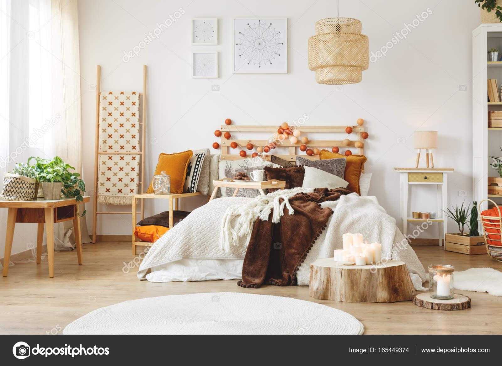 Messy bed in bedroom — Stock Photo © photographee.eu #165449374