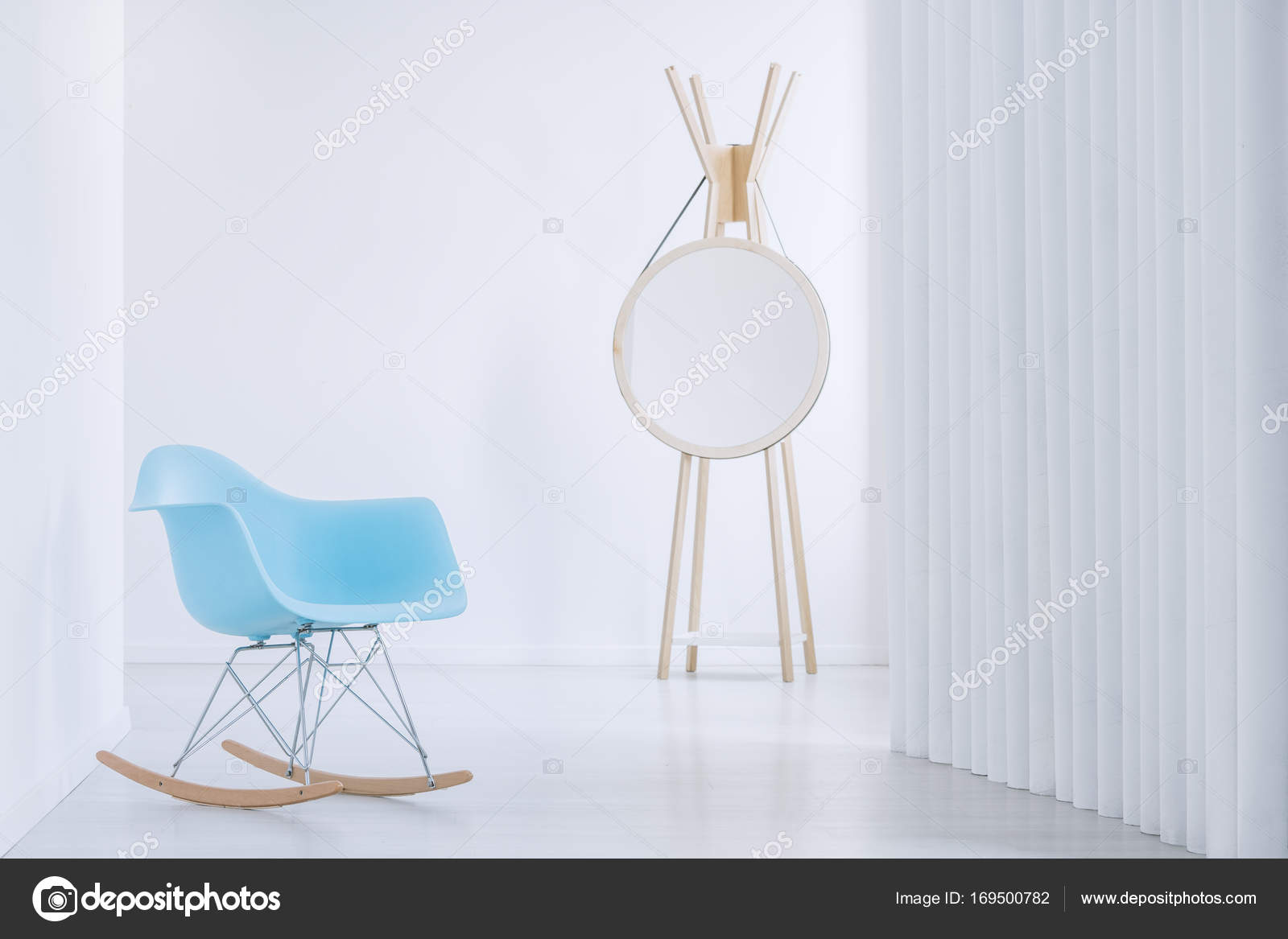 Close Up Of Blue Rocking Armchair And Modern Round Mirror Next To A Wall Photo By Photographee Eu