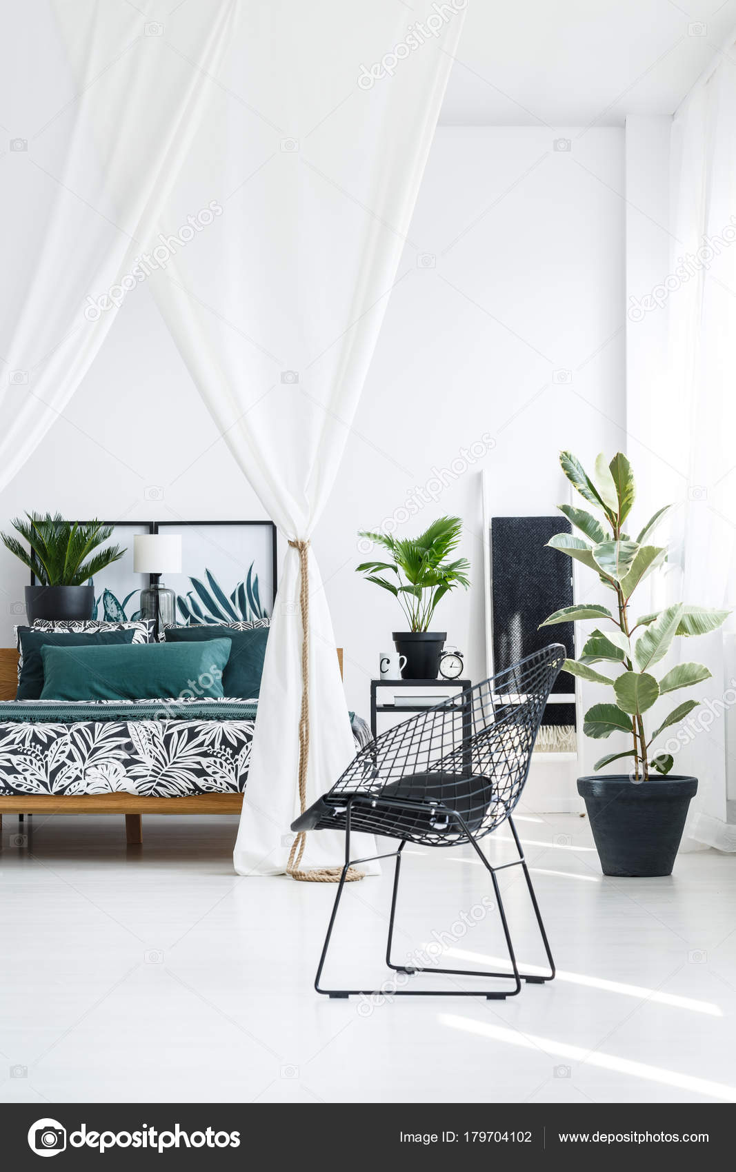 Designer black chair in bedroom — Stock Photo © photographee ...