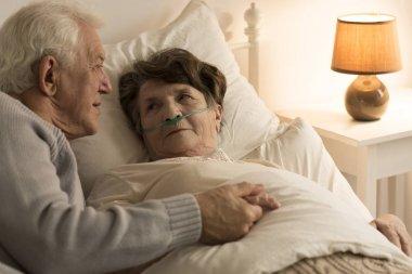 Man comforting sick wife