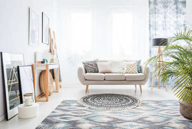Rug in front of sofa