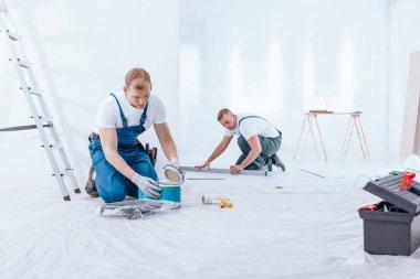 Painter during interior finishing work