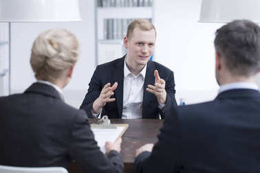 Young businessman convincing head manager