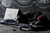 Fotografie Homeless sleeping on ground