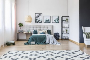 Spacious green bedroom interior