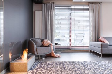 Fireplace in contemporary grey apartment
