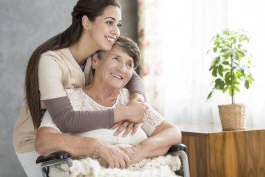 Smiling woman hugging grandmother