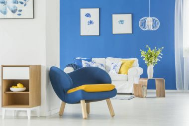 Yellow accents in blue room