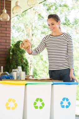 Eco friendly woman segregating waste
