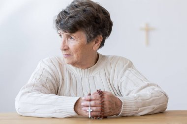 Religious grandmother with rosary