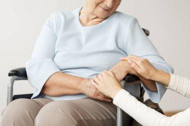 Caregiver supporting disabled pensioner