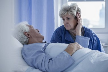Wife supporting husband in hospital