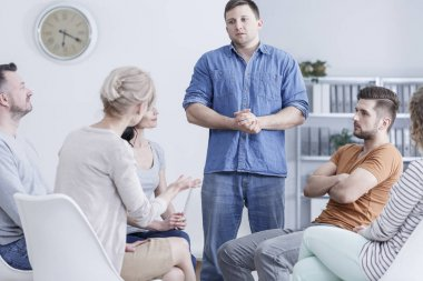 Man in therapy meeting