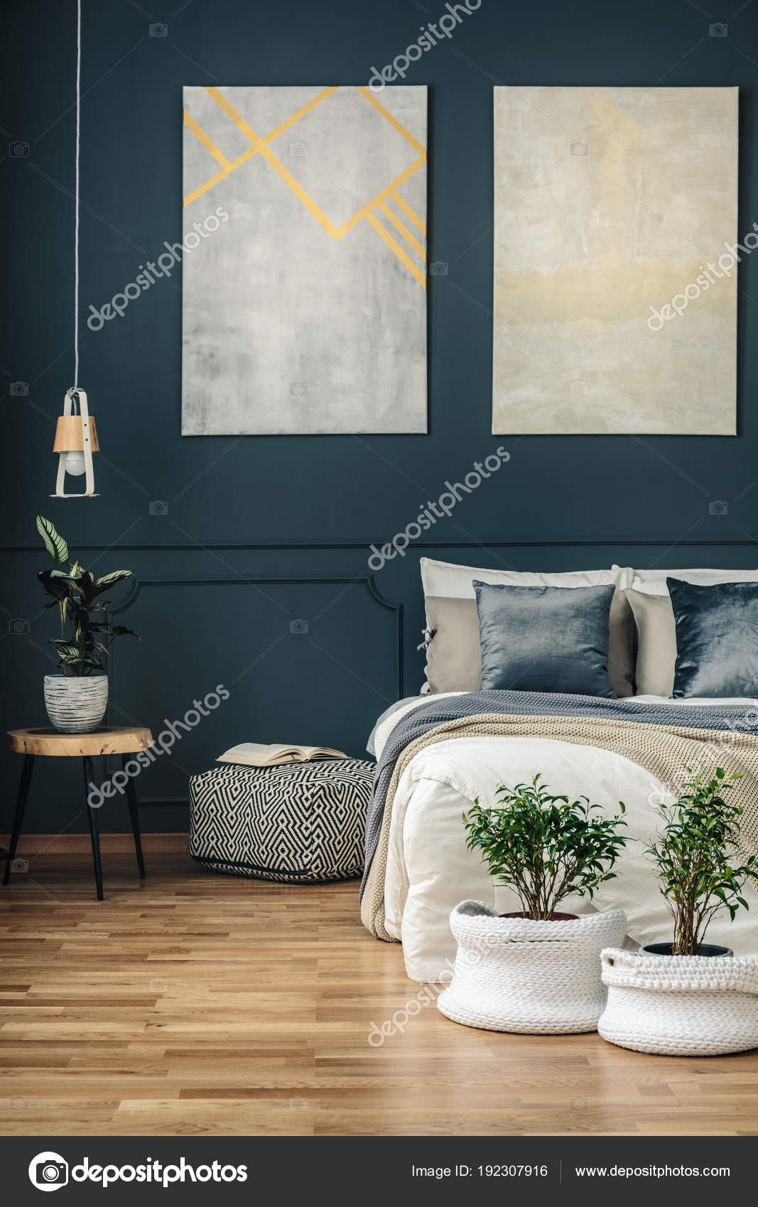 Navy blue bedroom with art stock photo