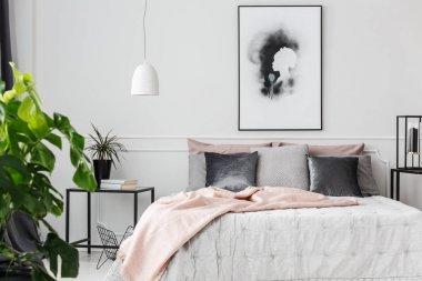 Pink blanket in feminine bedroom
