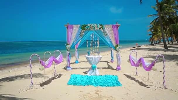 crimson, blue Wedding arch on the Caribbean beach