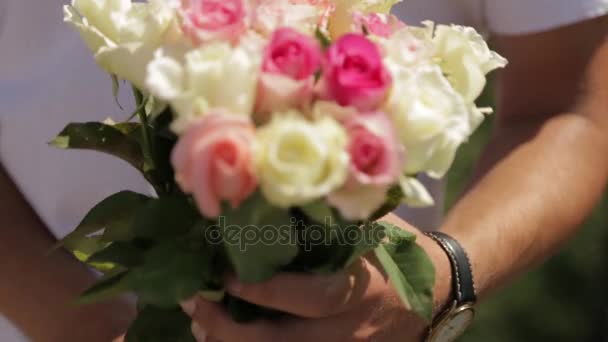 Romantic marriage proposal. Wedding ring and roses.