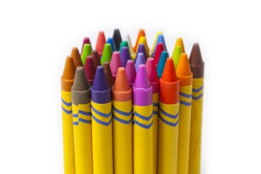 Colorful crayons grouped together over white background.