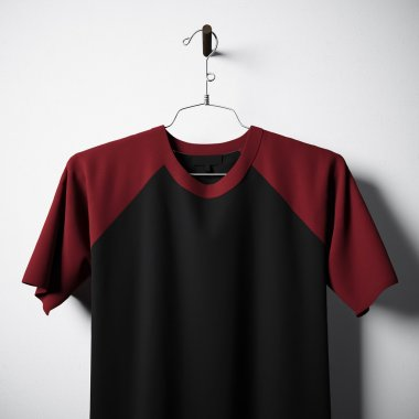 Closeup of blank cotton tshirt, black and red colors hanging in center empty concrete wall. Clear label mockup with highly detailed textured materials. Square. Front side view. 3D rendering.