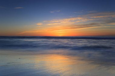 Seascape with tender waves and sunset end.