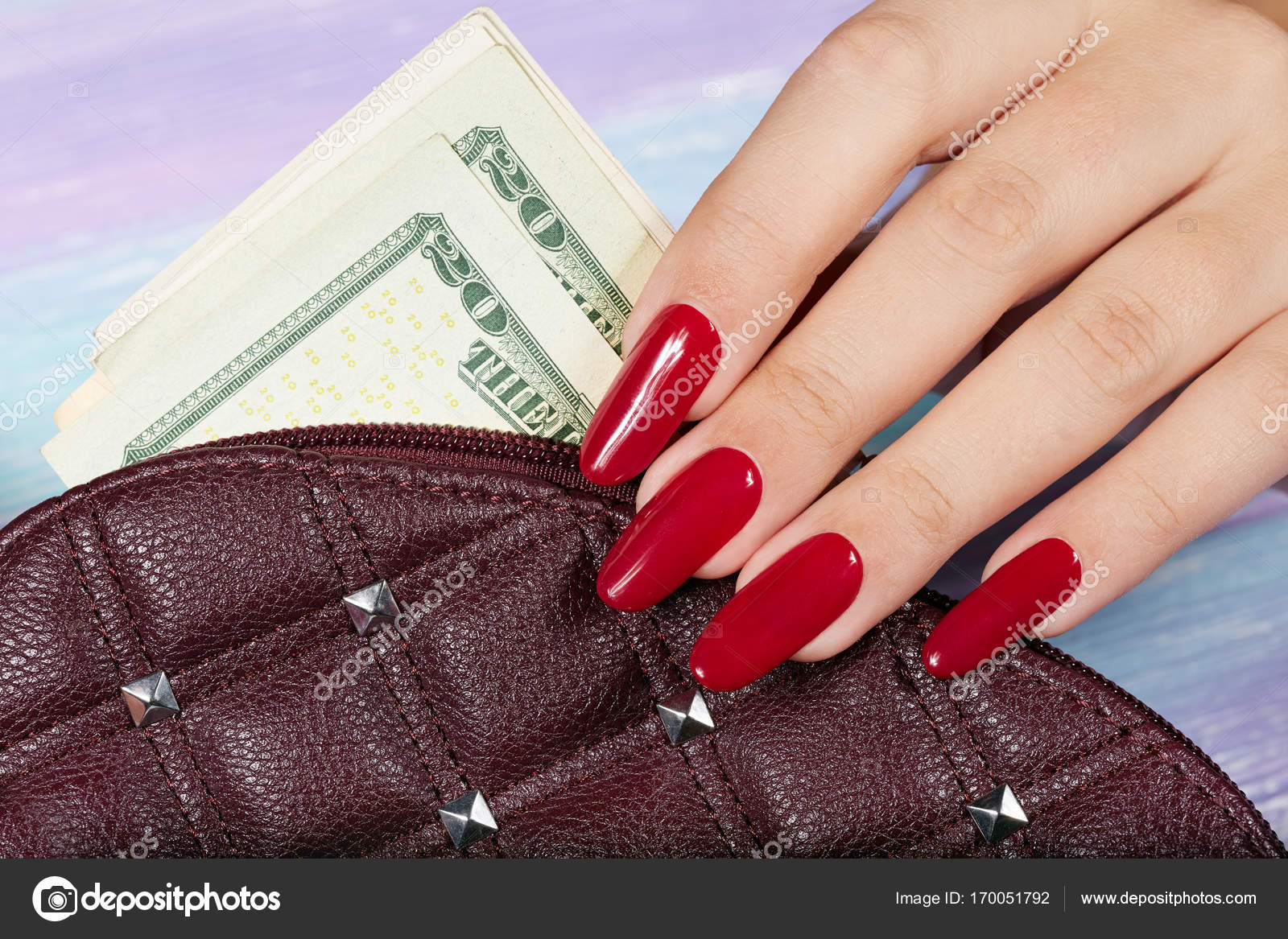 Hands with long artificial manicured nails colored with red nail ...