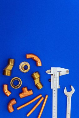 Set of tools for plumbing isolated on blue background with space for advertising