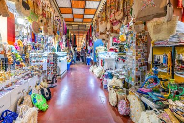 Agadir, Morocco - March 19, 2020: Moroccan people shopping and doing daily affairs on the market full of colorful products, Africa