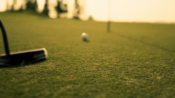 Putting Golf Ball on green in golf course hitting the golf ball to hole for birdie score, sports relax in holidays summer vacation at sunset golden time, cinematic Slow motion footage
