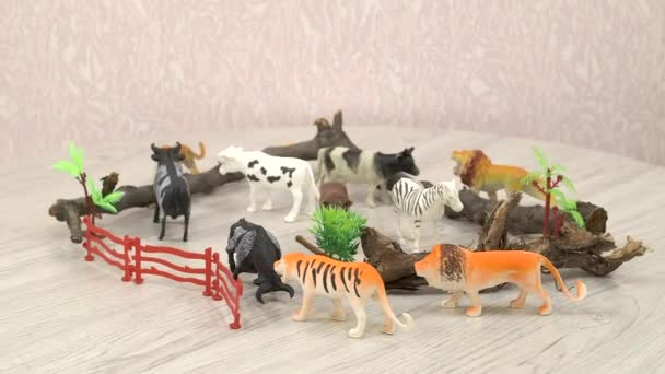 Colourful Kids toys collection - plastic wild animals on room floor