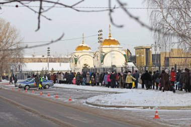 Krasnoyarsk, Russia, 01/19/2014 Illustrative Editorial The line in the cathedral for holy water on the feast of baptism.