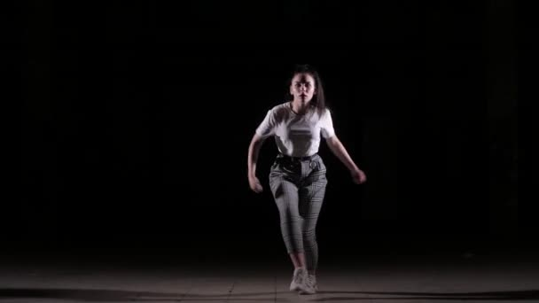 young beautiful girl dancing vogue in the studio on a black background, isolated