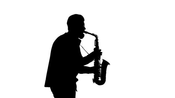 Előadása egy színész játszik a szaxofon, elszigetelt, sziluett, szóló