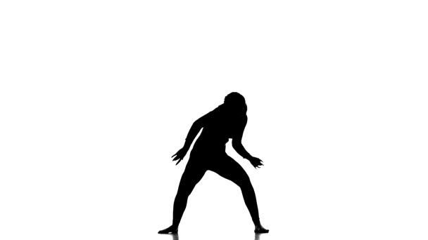 schwarze Silhouette auf weißem Hintergrund, junge schöne Tänzerin tanzt zeitgenössischen, modernen Balletttanz, Zeitlupe