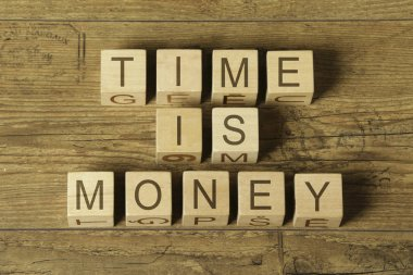 time is money text on cubes on wooden background