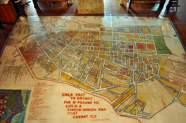 Cape Town, South Africa: the street map of the District Six, declared a Whites only region in 1965, with handwritten notes and poems from former residents on the floor of the District Six Museum, the memorial of the events of the apartheid era