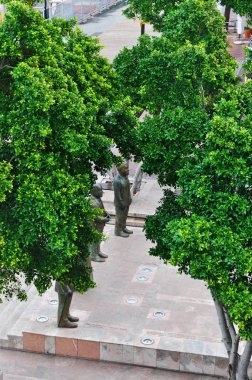 Cape Town, South Africa: a glimpse of the statues of Nobel Square dedicated to South Africa's Nobel Peace Prize laureates Albert Luthuli, Desmond Tutu, Frederik de Klerk and Nelson Mandela