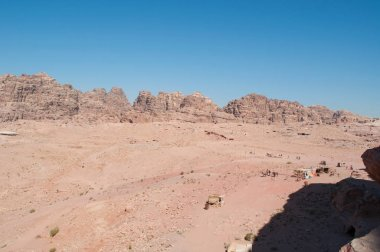 Jordan, Middle East: jordanian landscape and Bedouin tents where they sell food, drinks, jewelery and local crafts in the desert valley of the famous archaeological Nabataean city of Petra