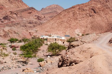 Jordan, Middle East: desertic landscape with view of Feynan Eco Lodge, a solar powered retreat in the Dana Biosphere Reserve, part of The Royal Society for the Conservation of Nature