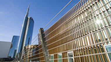 Unicredit tower and pedestrian bridge seen from Piazza Alvar Aalto, Milan, Italy