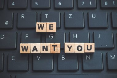 We want you letters, wooden, close up . Human resources.