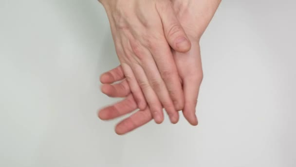 Man clapping with his handson white background. Close up.