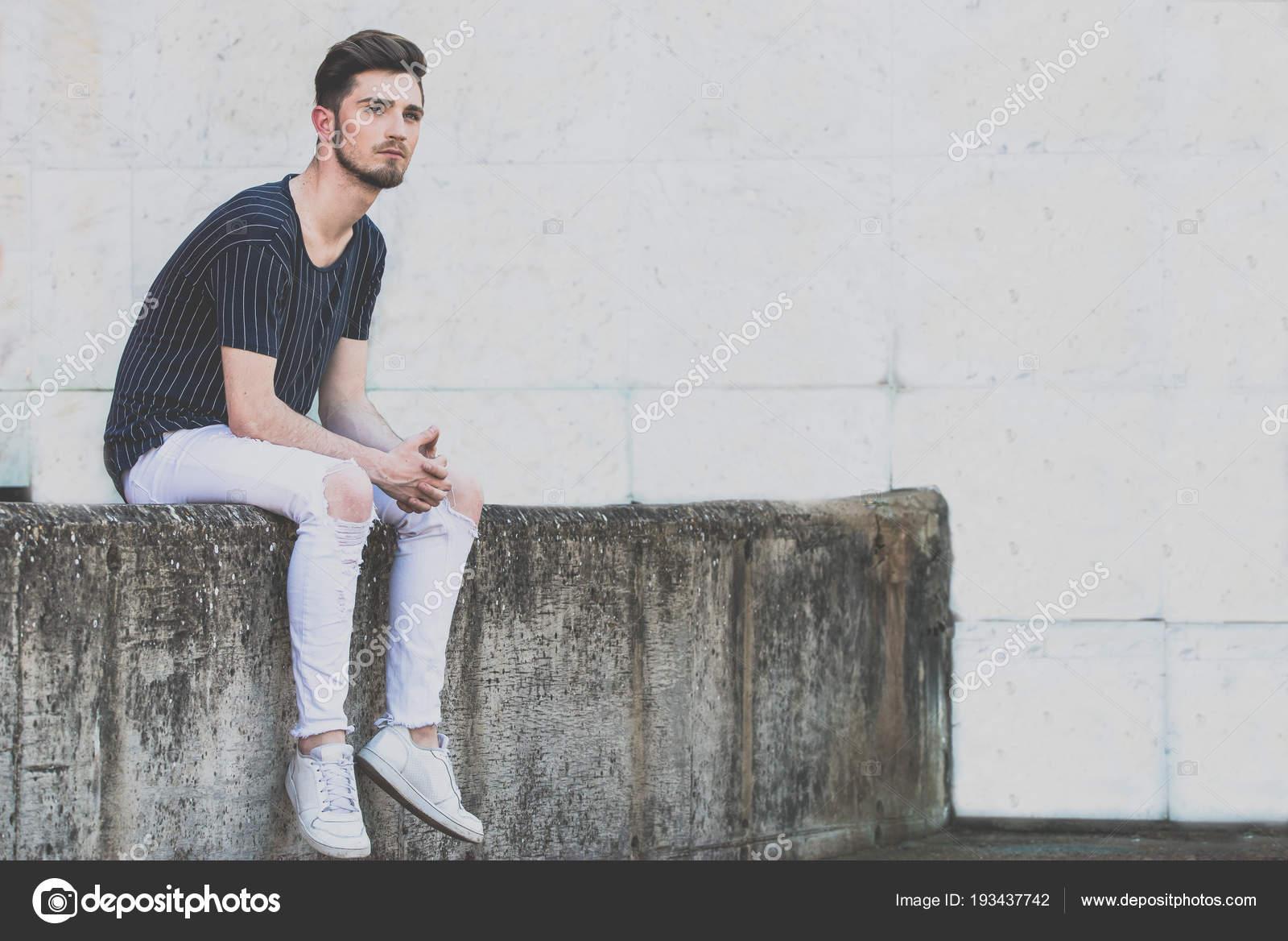 sitting on a man