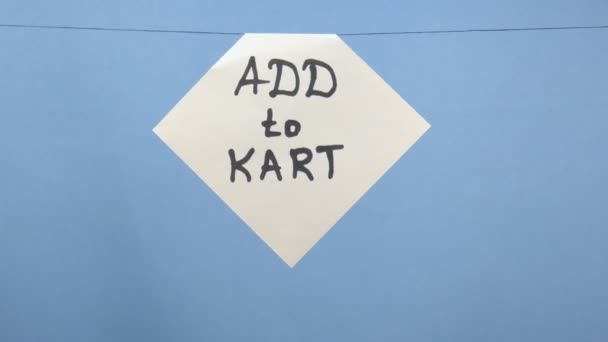 Égő és füstölgő fehér papírlap, fekete felirattal, kék alapon hozzáadni a kartonhoz