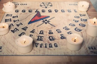 Ouija for communicating with human ghosts