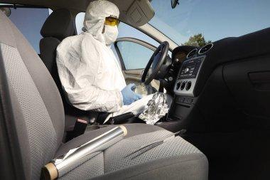 Criminologist technician collecting odor traces on crime scene