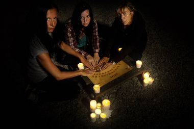 Woman witches in paranormal communication with ghosts