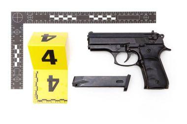 Police photo - evidence of handgun and magazine