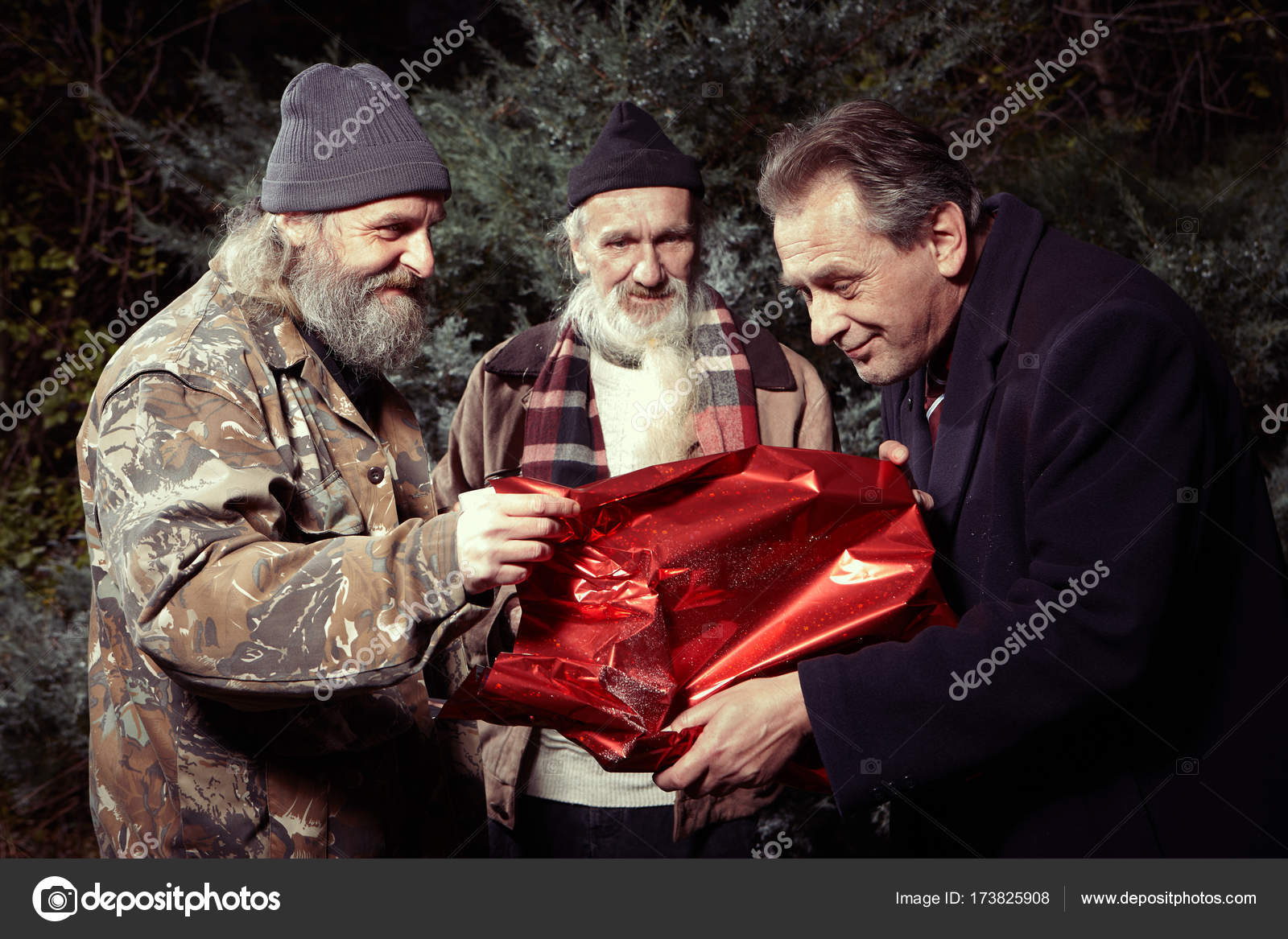 Man In Suit Get A Christmas Gift From Two Homeless Men Stock Photo